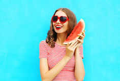 Fashion portrait happy smiling young woman is holding slice of watermelon Royalty Free Stock Photography