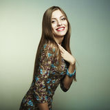 Fashion portrait of a happy young woman smiling Stock Photos