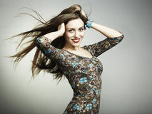 Fashion portrait of a happy young woman smiling Royalty Free Stock Image