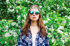 Fashion portrait hippie woman in flowering garden Royalty Free Stock Photos