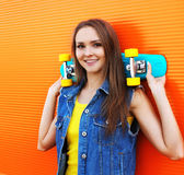 Fashion portrait of hipster pretty girl in colorful clothes Stock Images