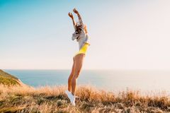 Fashion portrait of jumping happy woman in nature. Sporty woman outdoor. Fashion portrait of jumping happy woman in nature. Sporty woman Stock Image