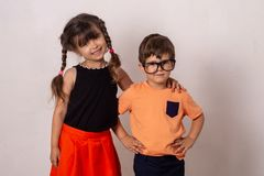 Fashion portrait kids standing on grey background. stock photos