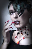 Fashion portrait of Lady vamp. Vampire gothic make-up style for halloween Royalty Free Stock Image