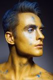Fashion portrait of man with artistic make-up Stock Photos