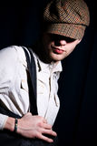 Fashion portrait of man in peaked cap Stock Images