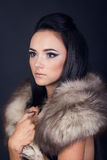 Fashion portrait of a model with a fur scarf Stock Photography