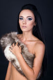 Fashion portrait of a model with a fur scarf Stock Photos