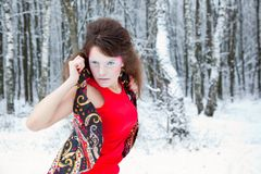 Fashion portrait of a model with make-up in forest Royalty Free Stock Photo