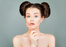 Fashion Portrait of Model Woman Eating Colourful Lollipop Royalty Free Stock Images