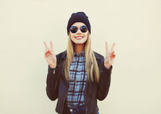 Fashion portrait of pretty blonde girl in trendy rock style Stock Photos