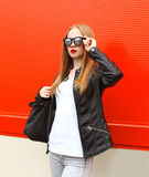 Fashion portrait pretty blonde woman wearing a rock black leather jacket Royalty Free Stock Images