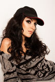 Fashion portrait of pretty brunette woman in a cap Royalty Free Stock Images