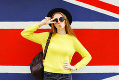 Fashion portrait pretty cool girl having fun over backgund royalty free stock photography