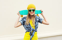 Fashion portrait pretty cool smiling girl with skateboard over white Royalty Free Stock Photo