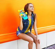 Fashion portrait of pretty girl in colorful clothes Stock Images