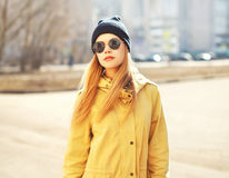 Fashion portrait of pretty hipster blonde girl outdoors Royalty Free Stock Photos