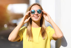 Fashion portrait pretty smiling girl in sunglasses enjoying Stock Photo