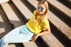 Fashion portrait pretty smiling woman in sunglasses posing Royalty Free Stock Photos