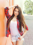 Fashion portrait of pretty woman model in checkered shirt Stock Photos