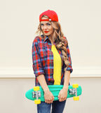 Fashion portrait of pretty woman in red cap Stock Photo
