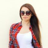 Fashion portrait pretty woman in sunglasses and checkered shirt Stock Photo