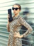 Fashion portrait pretty woman in sunglasses and leopard dress stock photo