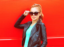 Fashion portrait pretty woman in sunglasses over red stock images