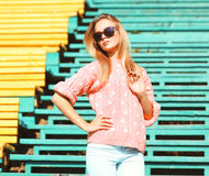 Fashion portrait pretty woman wearing a pink sweater Stock Image