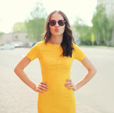 Fashion portrait of pretty woman wearing a yellow dress Stock Images