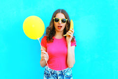 Free Fashion Portrait Pretty Woman With Banana And Yellow A Air Balloon Having Fun Over Colorful Blue Background Royalty Free Stock Photo - 88581355
