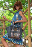 Fashion portrait of pretty young caucasian woman with handmade snakeskin python handbag. Sunny day on a tropical Bali Stock Photography