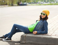 Fashion portrait of pretty young girl in sunglasses. Outdoors Royalty Free Stock Photography