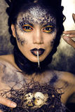 Fashion portrait of pretty young woman with creative make up like a snake Royalty Free Stock Photo