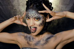 Fashion portrait of pretty young woman with creative make up like a snake. Close up Royalty Free Stock Photography