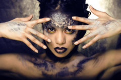 Fashion portrait of pretty young woman with creative make up like a snake. Close up Royalty Free Stock Photos