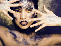 Fashion portrait of pretty young woman with creative make up like a snake Stock Photography