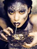 Fashion portrait of pretty young woman with creative make up lik. E a snake, halloween close up Stock Photography