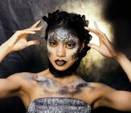 Fashion portrait of pretty young woman with creative make up lik. E a snake, halloween fashion look Royalty Free Stock Images