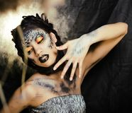 Fashion portrait of pretty young woman with creative make up lik. E a snake, halloween fashion look Royalty Free Stock Photo