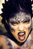 Fashion portrait of pretty young woman with creative make up like a snake, halloween look. Close up royalty free stock photos