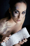 Fashion portrait of pretty young woman with creative make up like a snake. And python clutch Royalty Free Stock Image