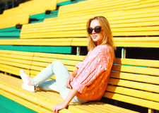 Fashion portrait pretty young woman resting on bench Royalty Free Stock Images