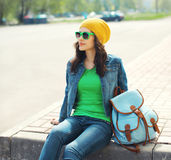 Fashion portrait of pretty young woman in sunglasses and jeans Stock Photo