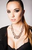 Fashion portrait of pretty young woman wearing bra and necklace. Fashion portrait of a pretty young woman wearing bra and necklace Stock Images