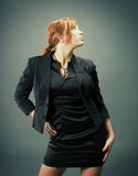 Fashion portrait of a red hair sexy woman Stock Photography
