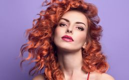 Fashion Portrait Sensual Redhead Woman on Purple. Fashion Portrait Beautiful Redhead woman on Purple. Sensual Girl with Trendy Wavy Curly Hairstyle. Gorgeous royalty free stock image