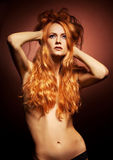 Fashion portrait of sensual redhead young woman Royalty Free Stock Photo