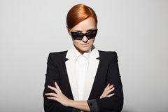 Fashion portrait of serious woman dressed as a secret agent Royalty Free Stock Images