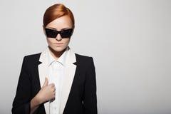 Fashion portrait of serious woman dressed as a secret agent Stock Images